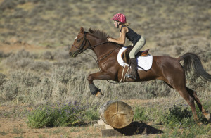 Girl Jumping Her Horse